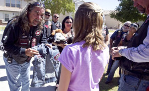 bikers  11160424kb Pipes, of the Bikers Against Child Abuse, gives a jean vest with the groups patch on the back to a child abuse victim. The group gives children in foster care the protection of a bunch of really big people wearing leather and riding motorcycles. Anonymity is part of their protection so they give the kids their very own biker name. Pat Shannahan/The Arizona Republic